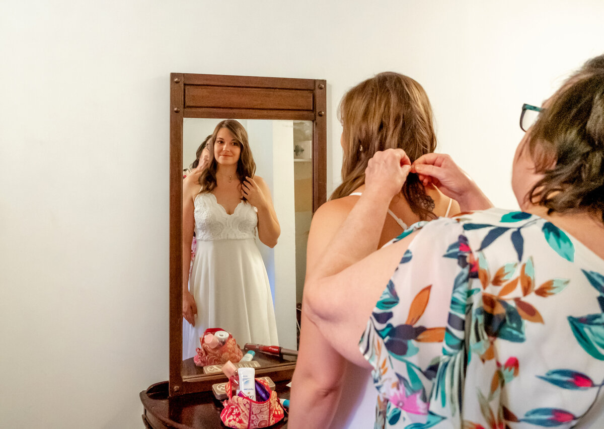 Blowing Rock Wedding Photography - Rhiannon and Chris - Bride Getting Dressed with Mother - Wilmington NC Photographers Team