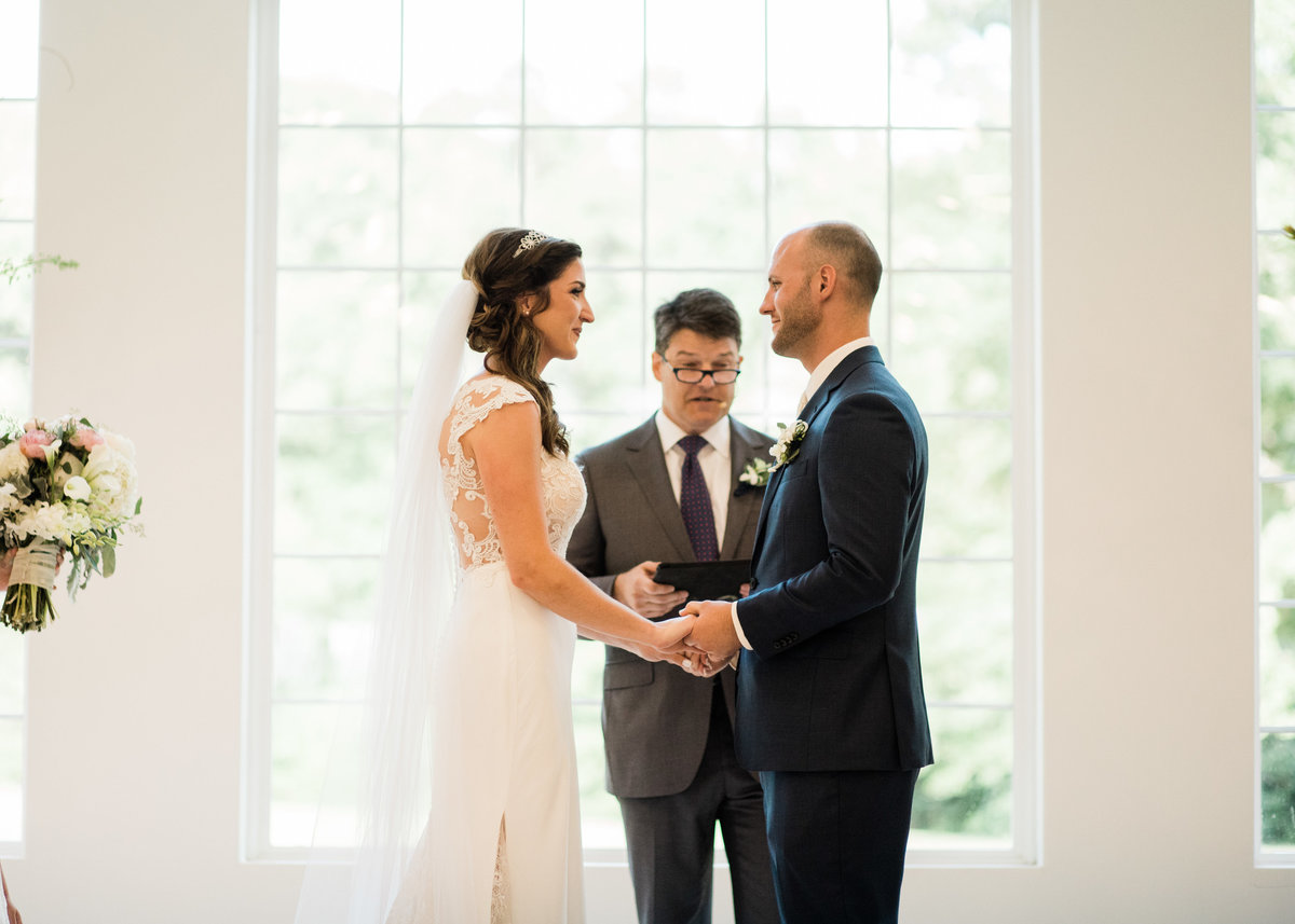 "bride and groom say ""I Do"" at The Grandeur House / Katie Childs Photo"