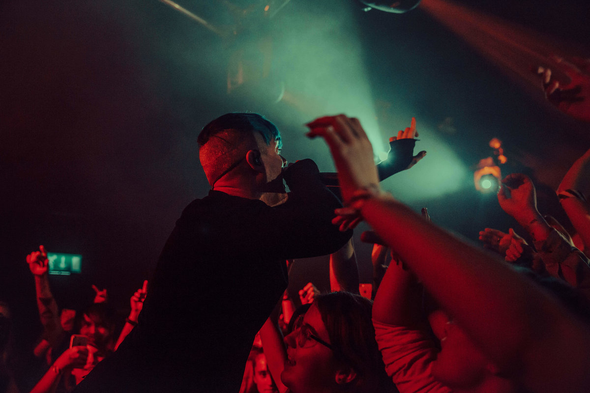 A shot from behind of Cody Carson, singer of Set It Off in the crowd at The Garage in London