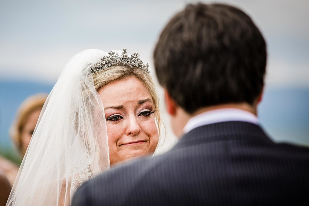 A bride reacts to her groom during a wedding ceremony in Colorado.