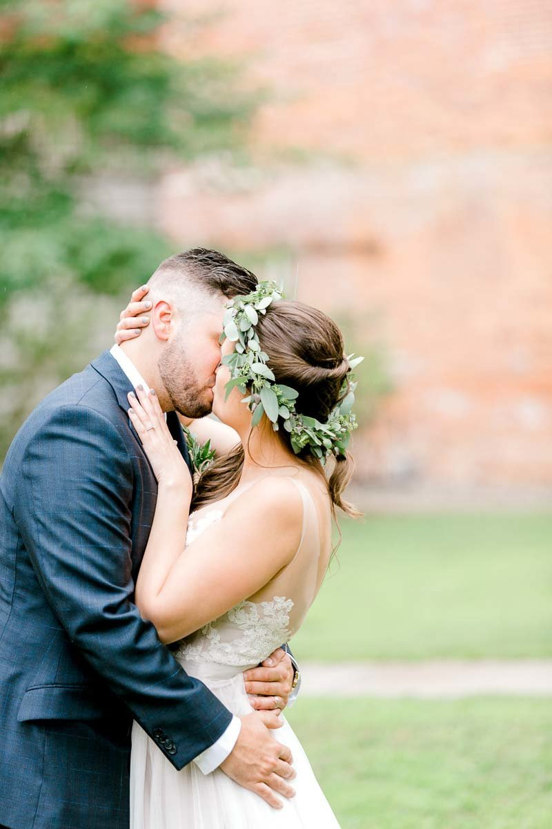 Bride and Groom Kissing on their wedding day.  Image taken by K. Lenox Photography