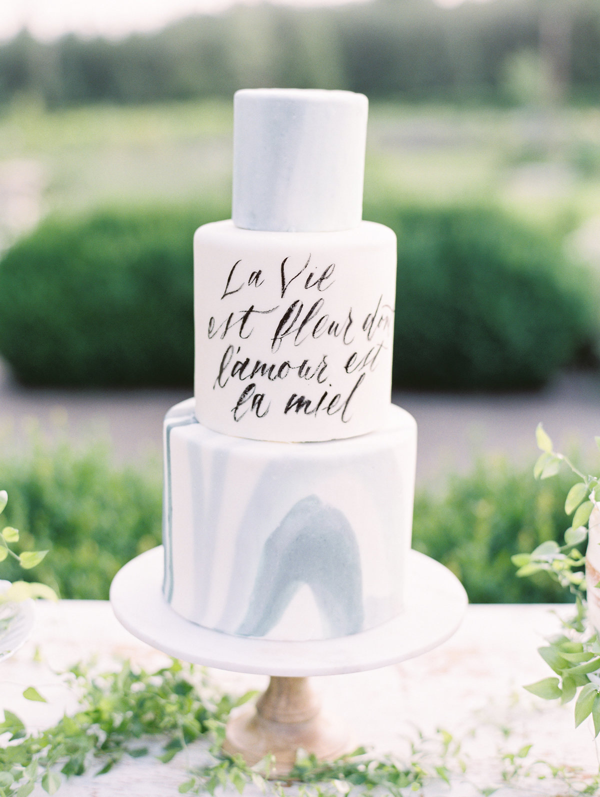 marble wedding cake with custom calligraphy