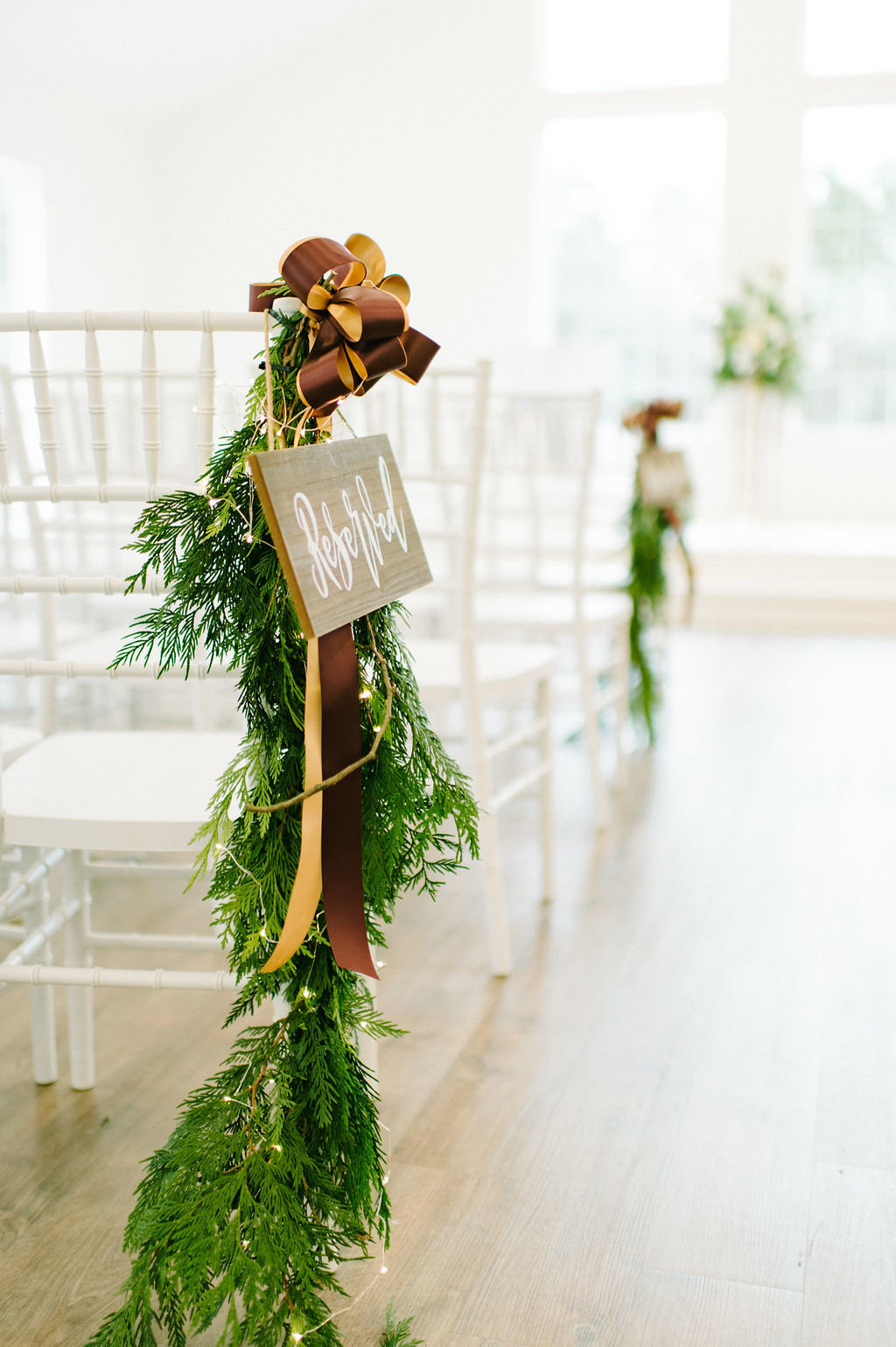 Garland to mark reserved seating at The Grandeur House / Tyler Rosenthal Photography