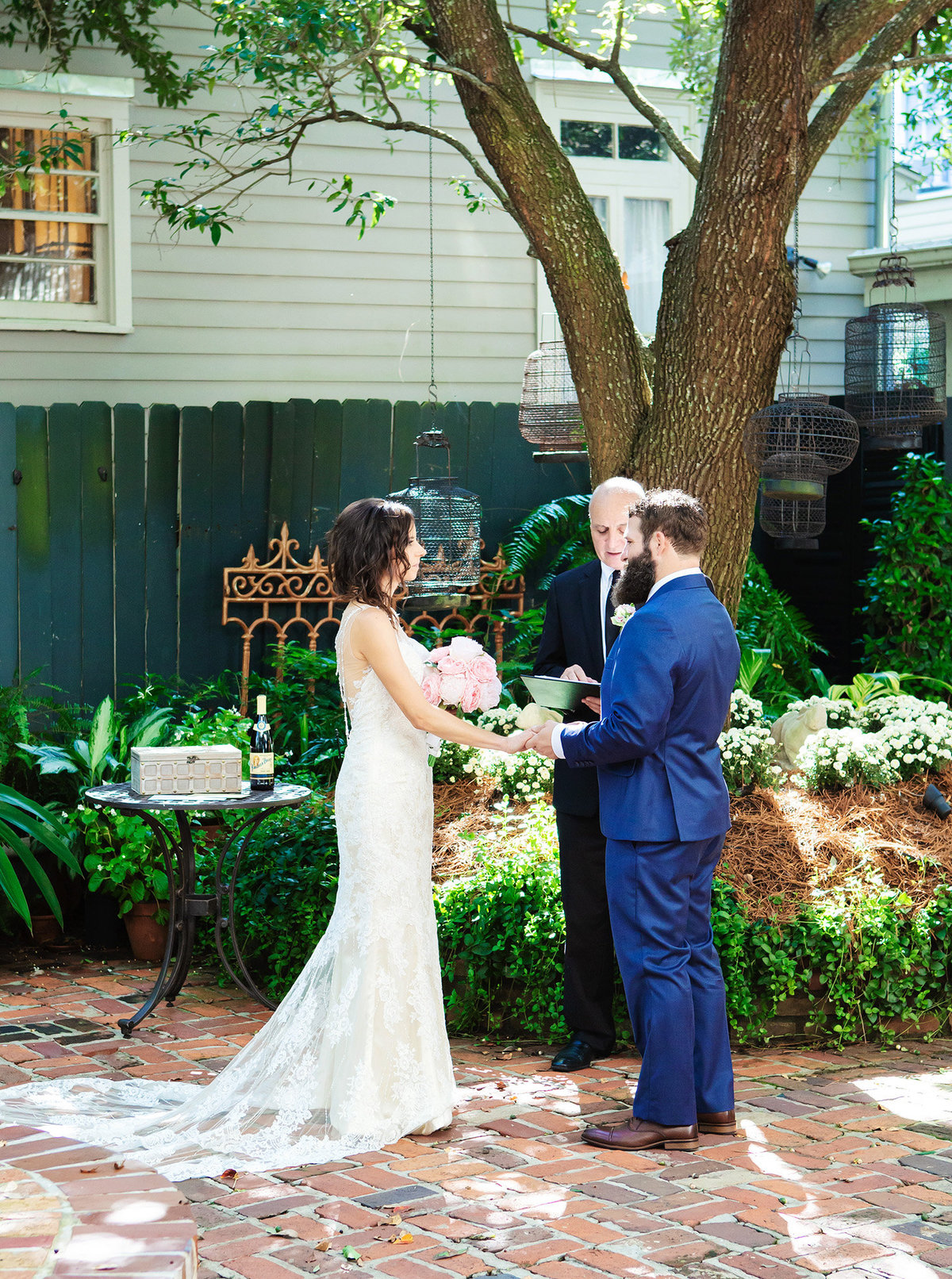 wedding couple saying their vows in the courtyard of The Terrell House