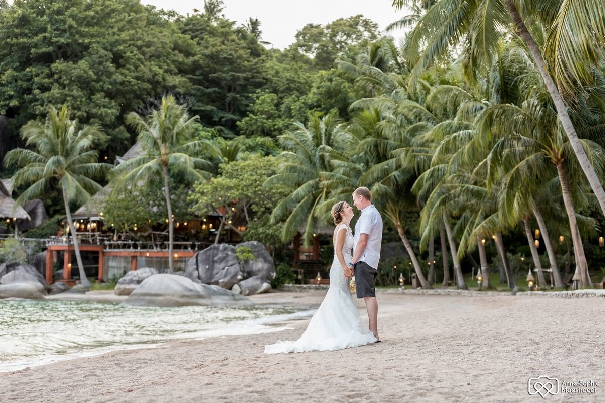 Bride and Groom kissing on beach on Koh Tao