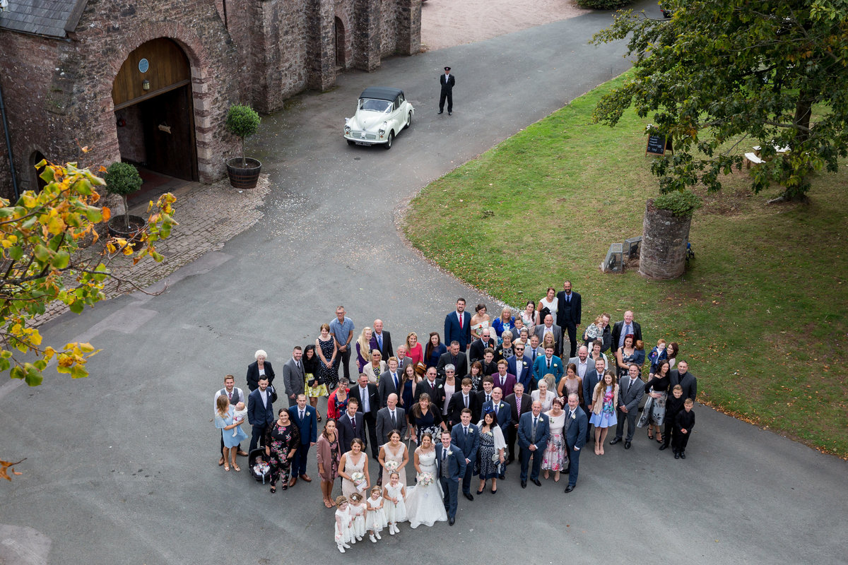 group wedding photo at torre abbey