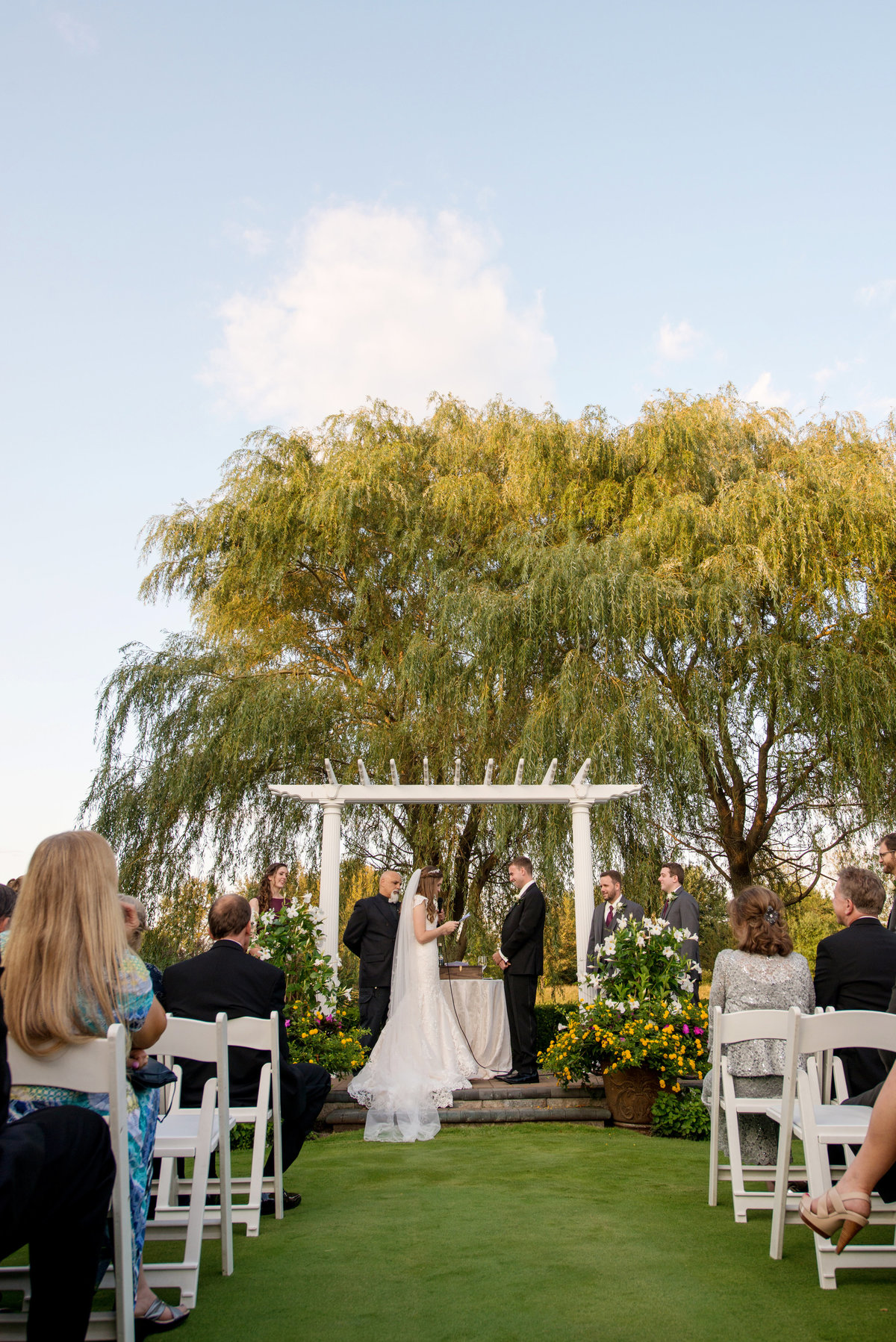 photo of ceremony with bride and groom during wedding at Willow Creek Golf and Country Club