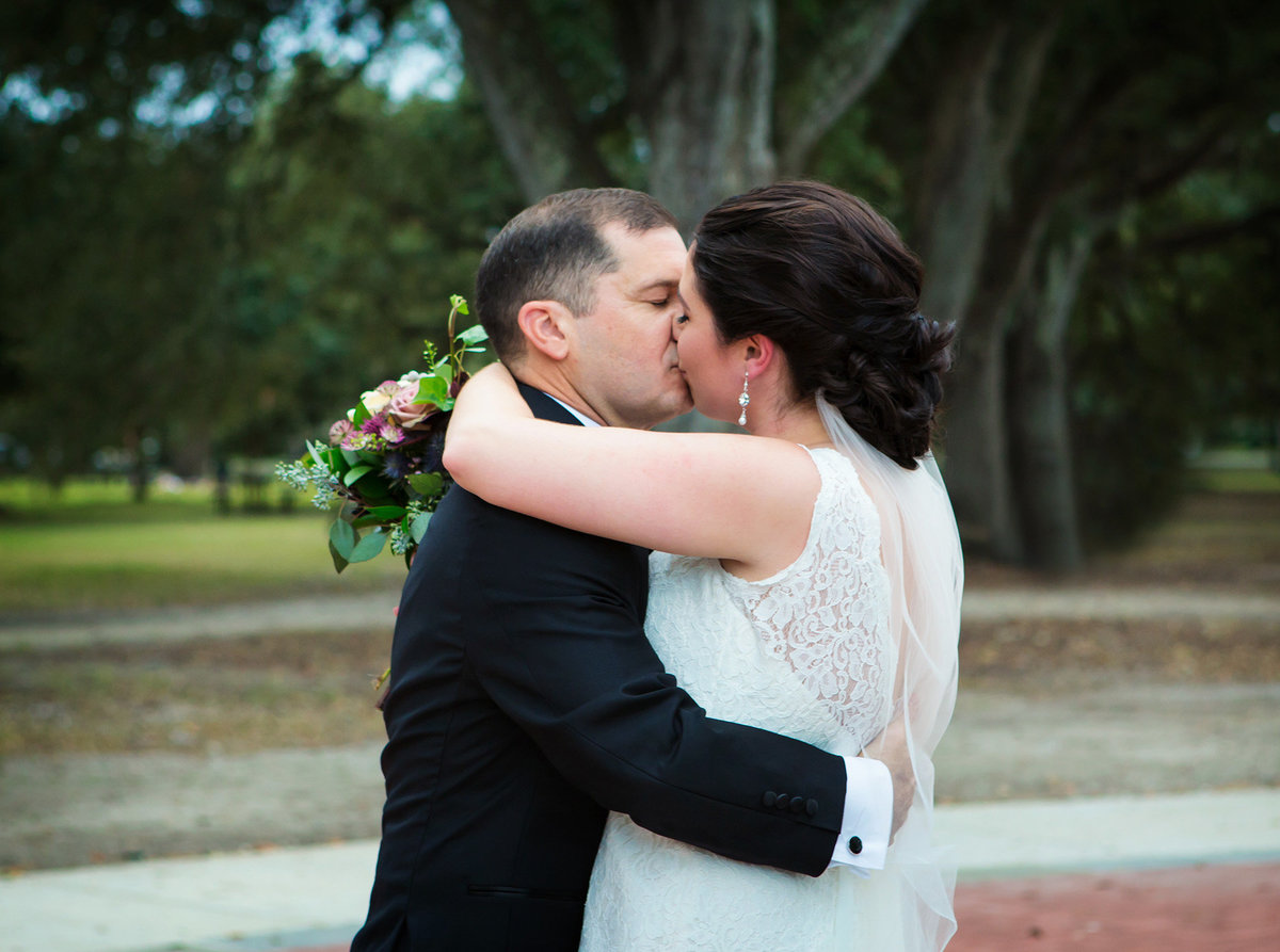 New Orleans wedding couple kiss after just being married in Audubon Park