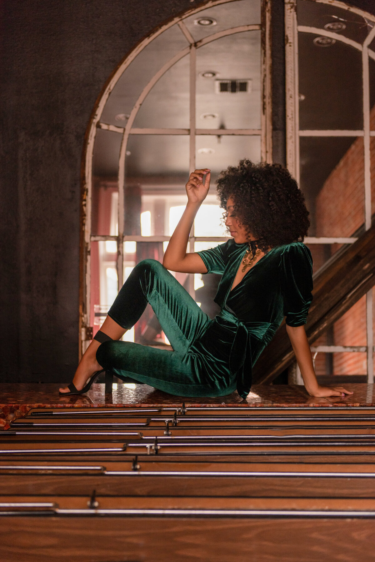 woman-in-green-velvet-jumpsuit-posed-personal-branding-Iowa City-440