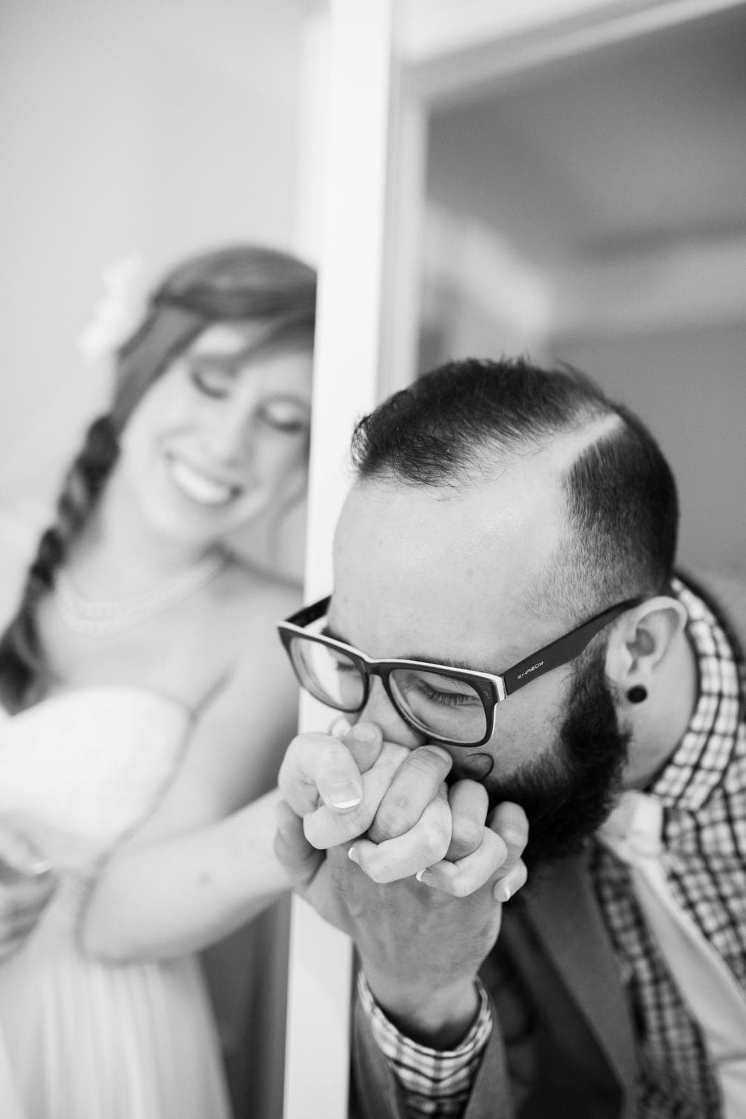 Groom kissing bride's hand Mike Glatzer Photography