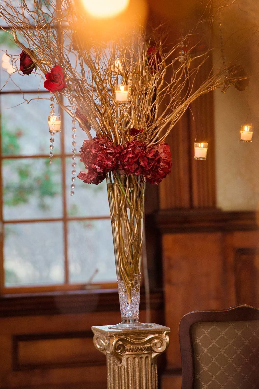 Red floral centerpiece at The Mansion at Oyster Bay