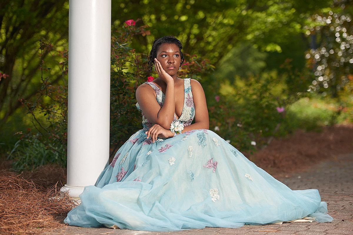 Women in blue prom dress portrait