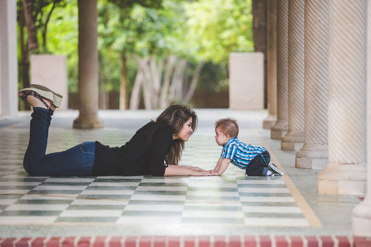 sister and brother posing for portrait on the floor by San Antonio photographer Expose The Heart