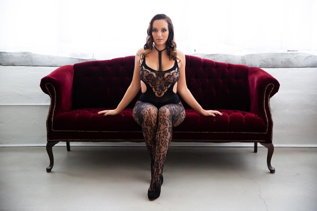 Brunette-woman-in-black-lace-full-body-suit-syracuse-newyork-boudoir2
