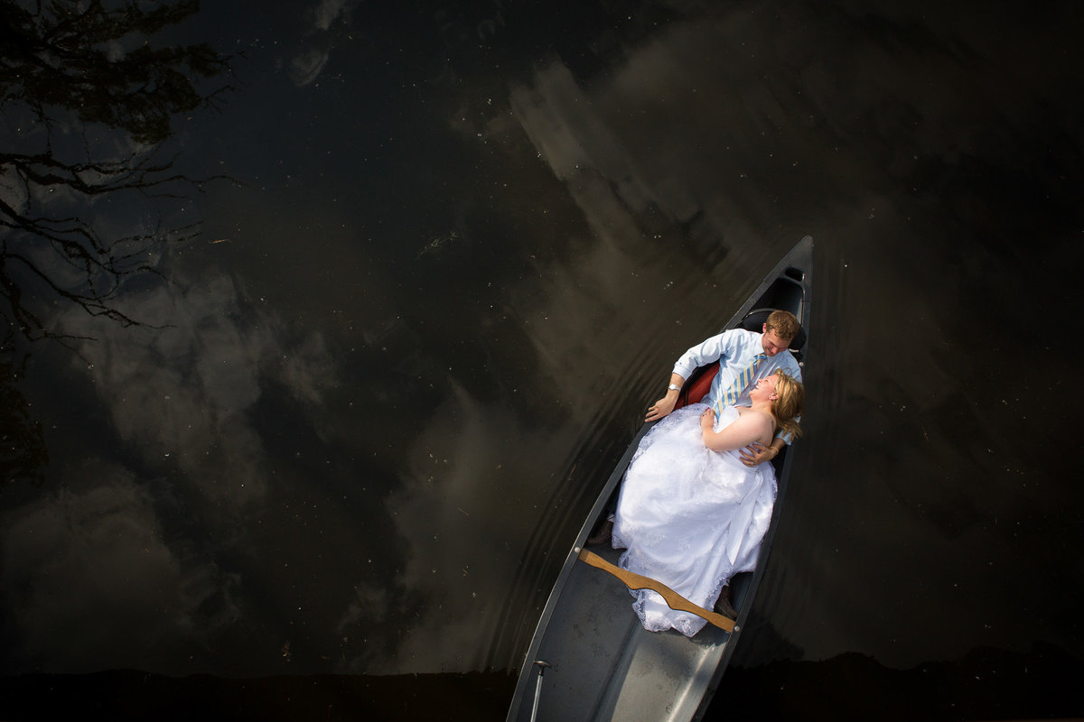 Trash The Dress session on a canoe for a bride and groom