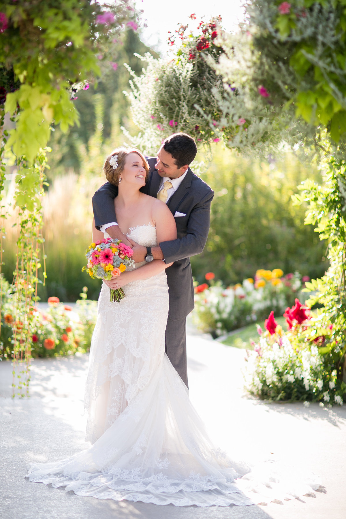 bride and groom under the arbor at brookside gardens