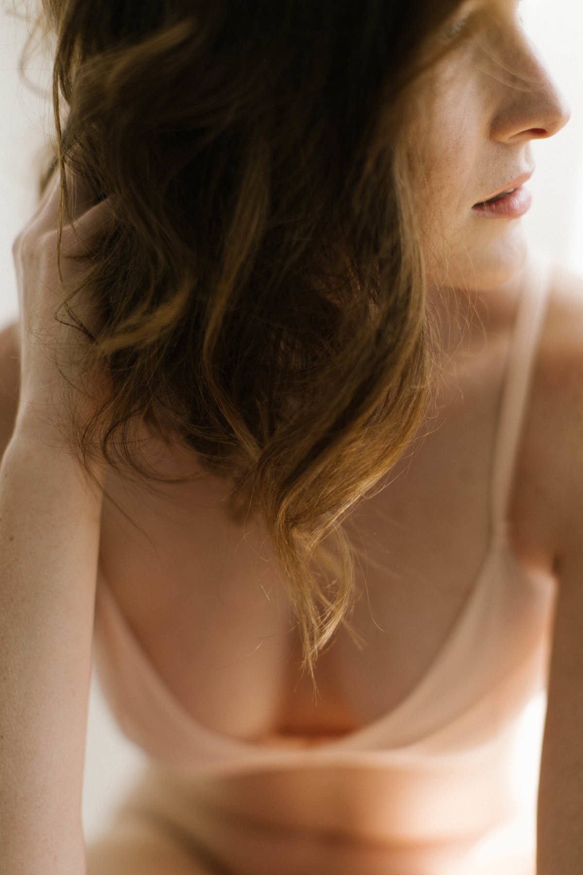 Woman with peach lingerie during boudoir session