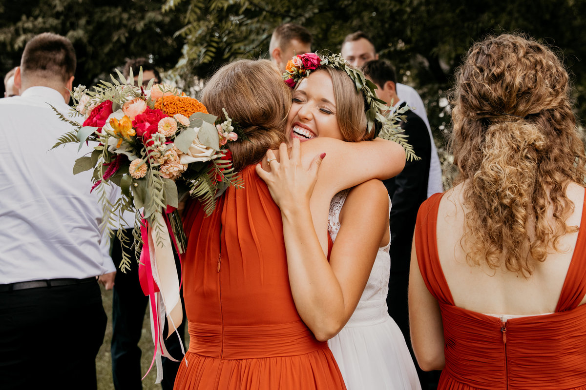chicago-wedding-photographer-candid-hug-friend