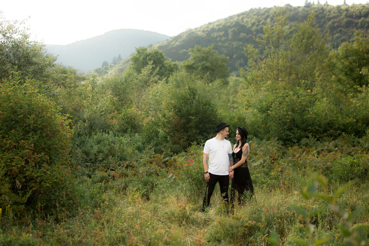 trendy engaged couple looking at each other in mountains of north carolina for atlanta wedding photographer