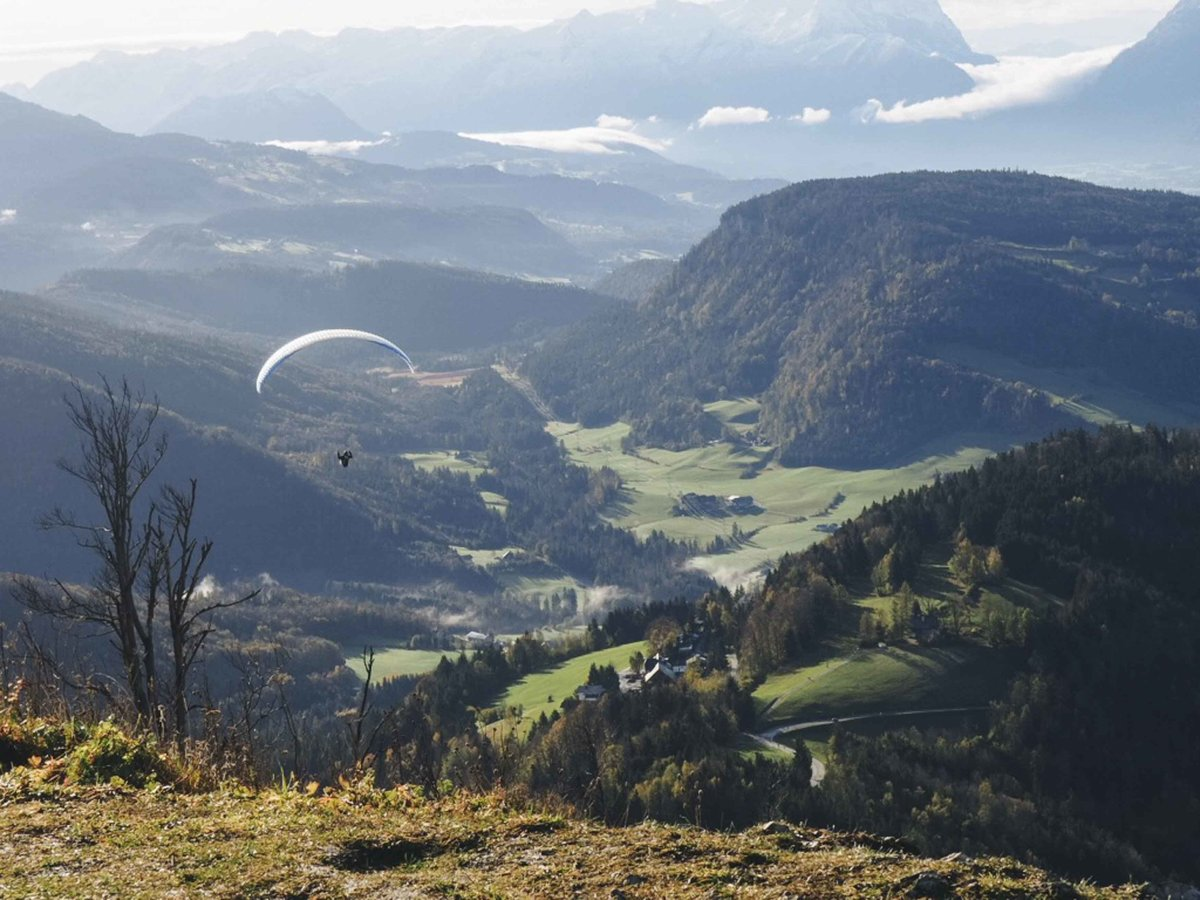 Austrian Mountains and man with parachute