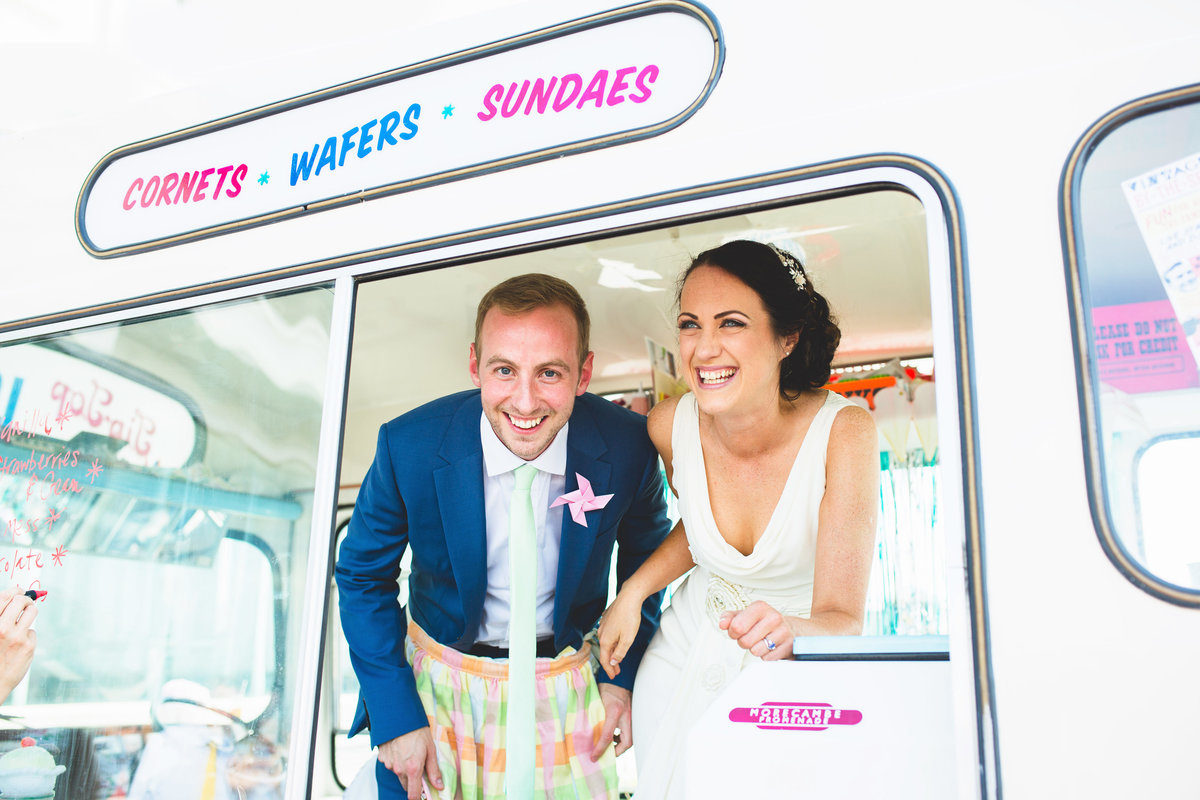 bride and groom in ice cream van at their wedding - unique quirky wedding photography