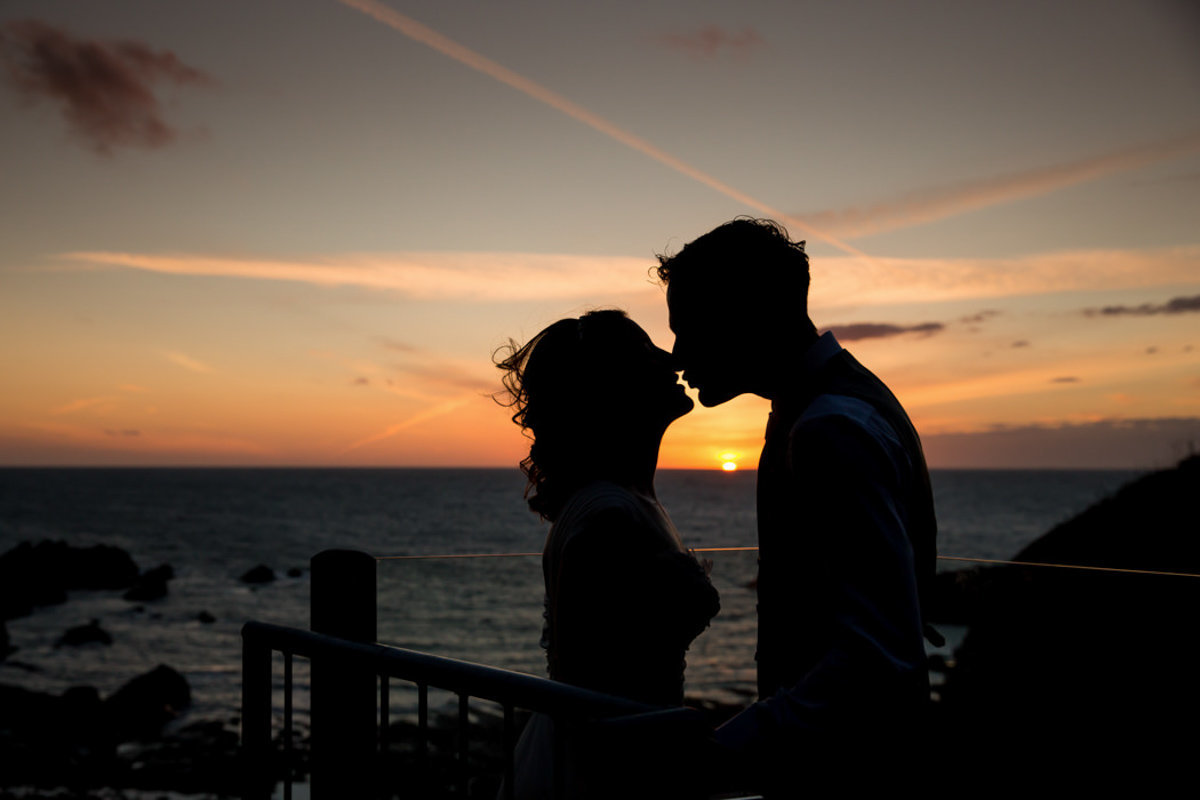 Sunset on the roof terrace with wedding couple at Tunnels Beaches