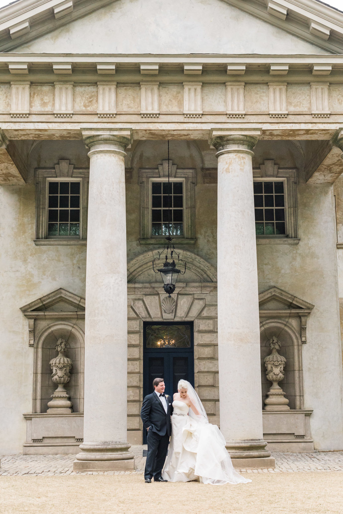 Romantic bride and groom photos in front of the Swan House. Photo by luxury destination wedding photographer Rebecca Cerasani.