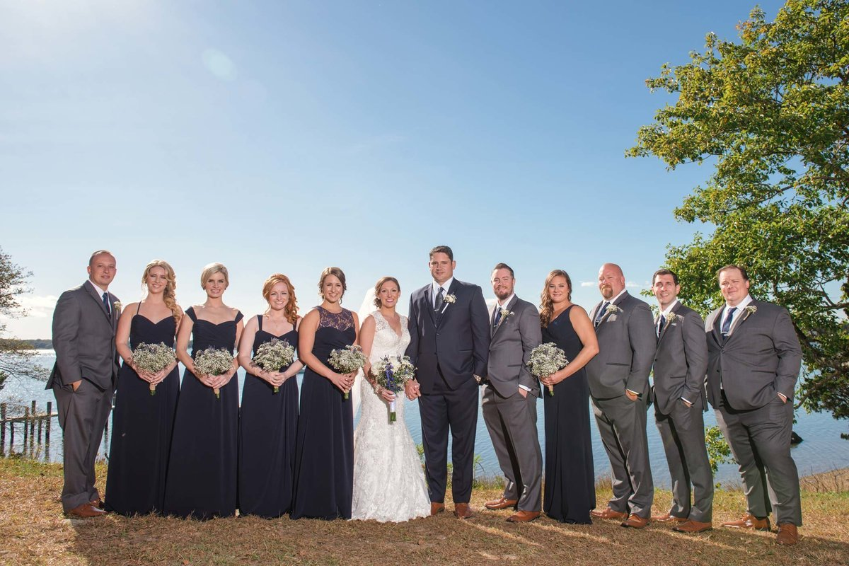 Bridal party by the water at The Ram's Head Inn