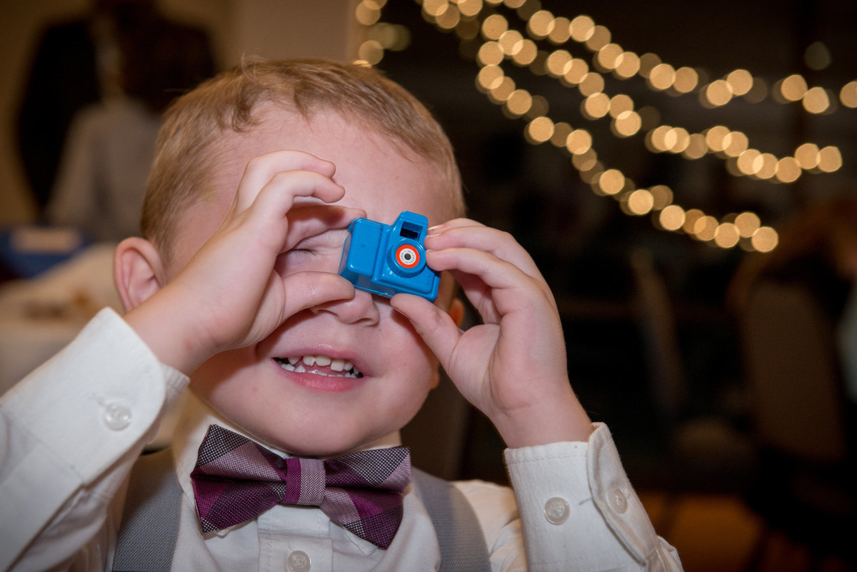 Ring bearer with toy camera