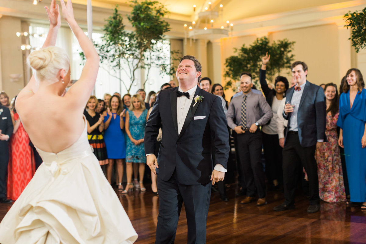 Brett and Mallory's first dance was full of fun and spunk! Photo by luxury destination wedding photographer Rebecca Cerasani.