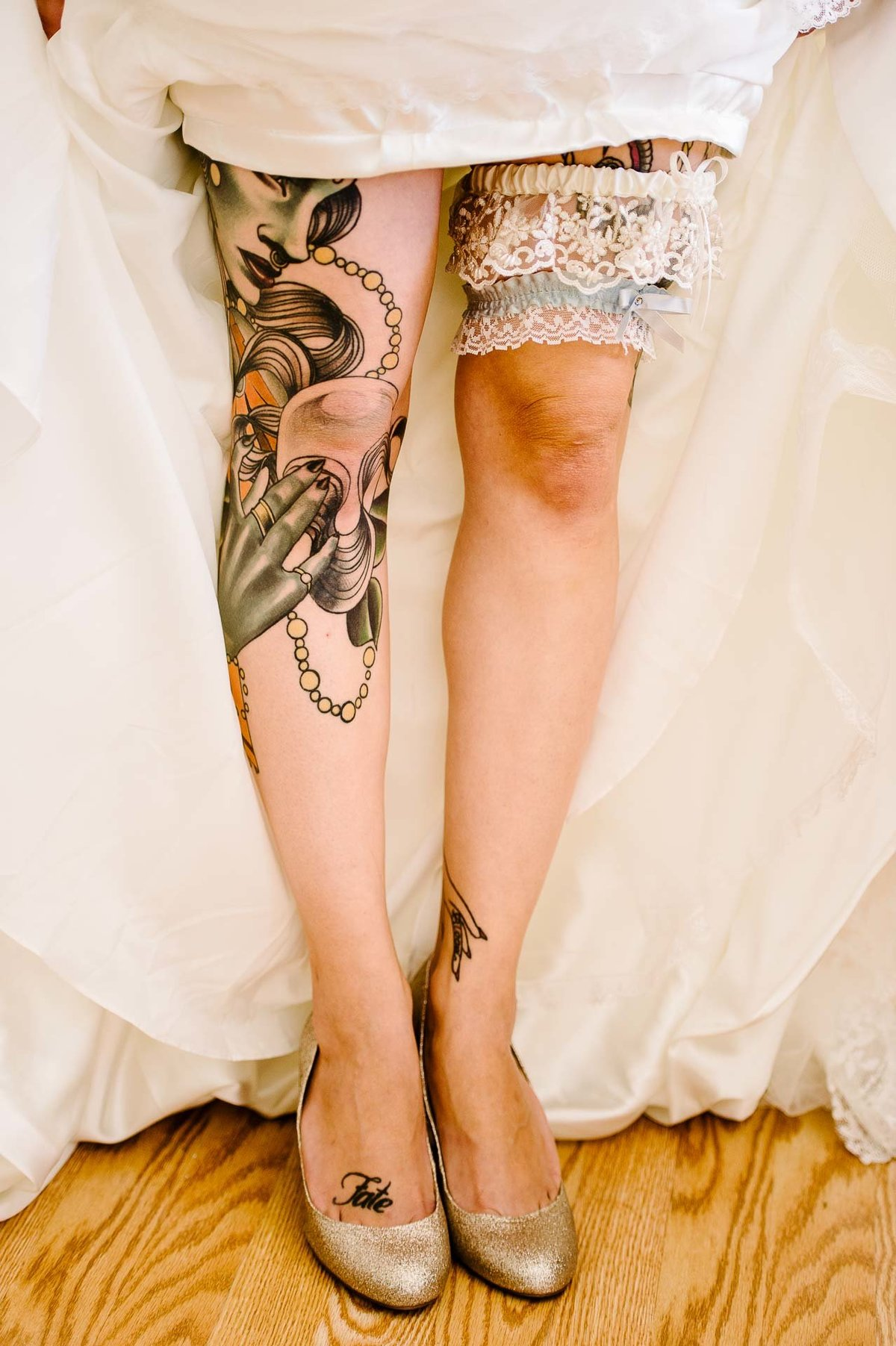 photo of the bride's legs with tatoo