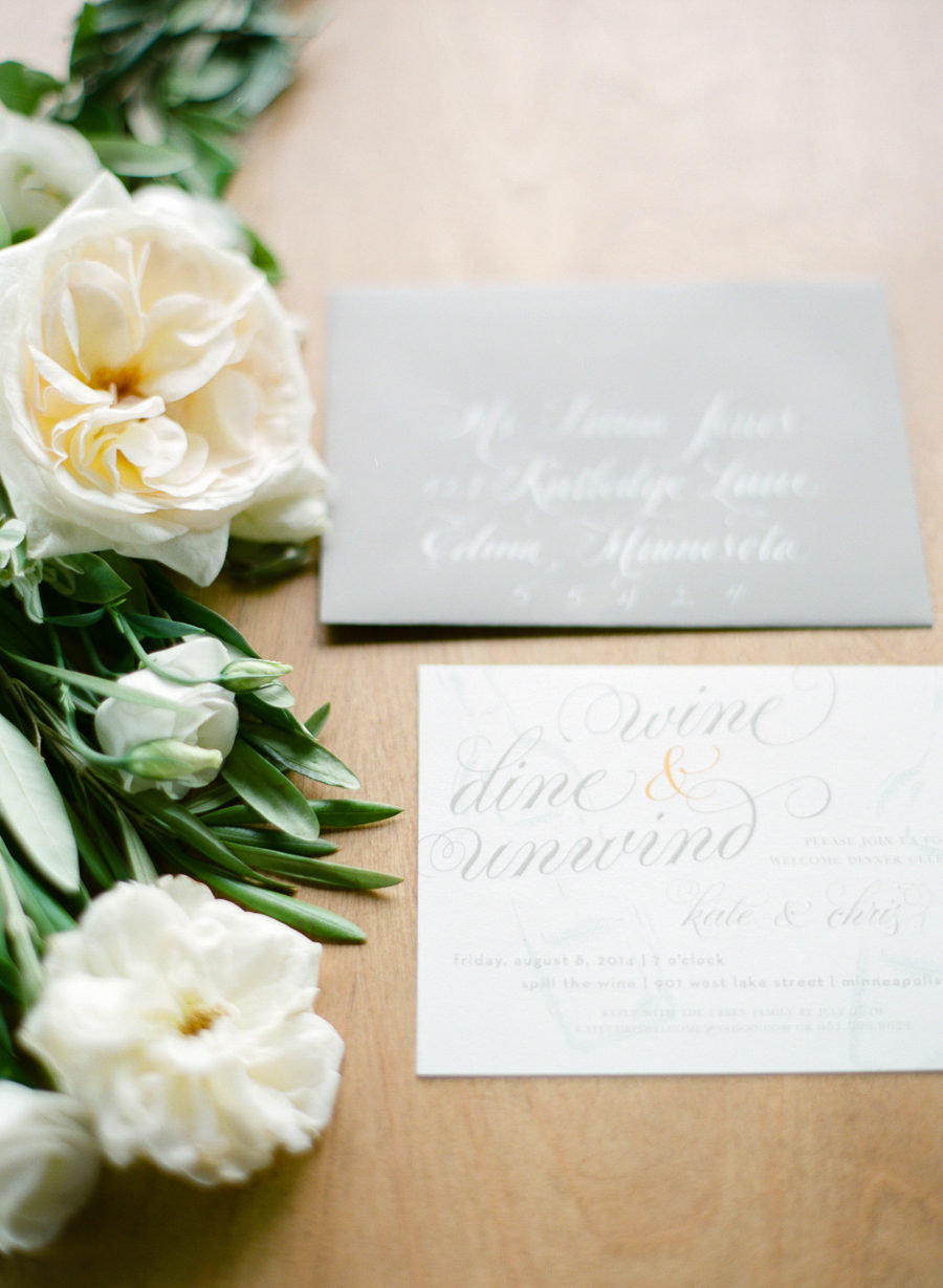 white flowers with wedding invitaions
