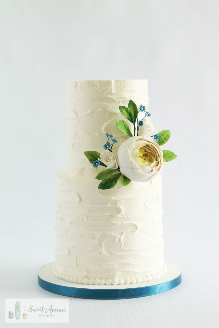 white textured buttercream cake with sugar flowers, Hamilton ON wedding cakes