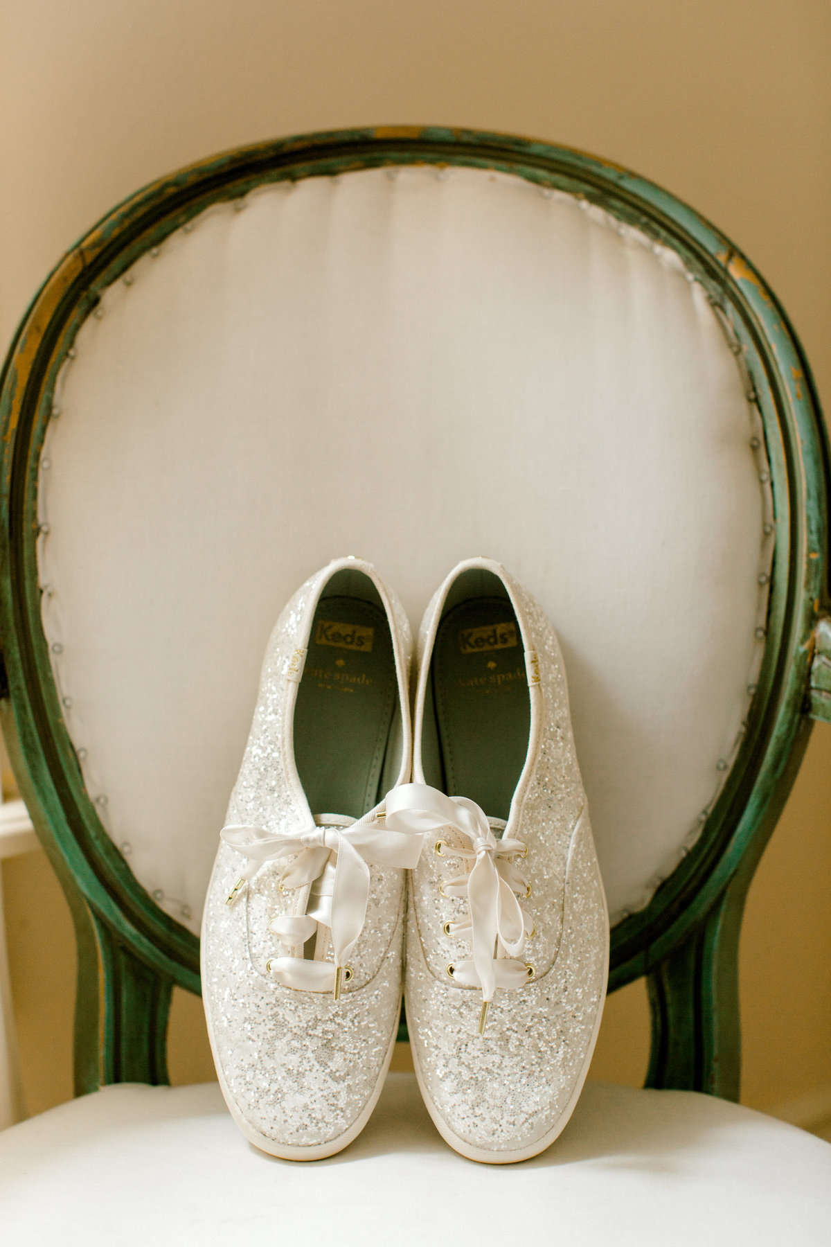 Close up of Kate Spade sparkle keds on vintage chair in bridal suite at Olympias Valley Estate in Petaluma California