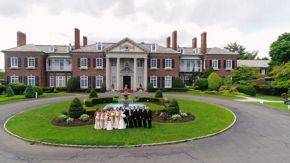 drone photo of the bridal party at Glen Cove Mansion
