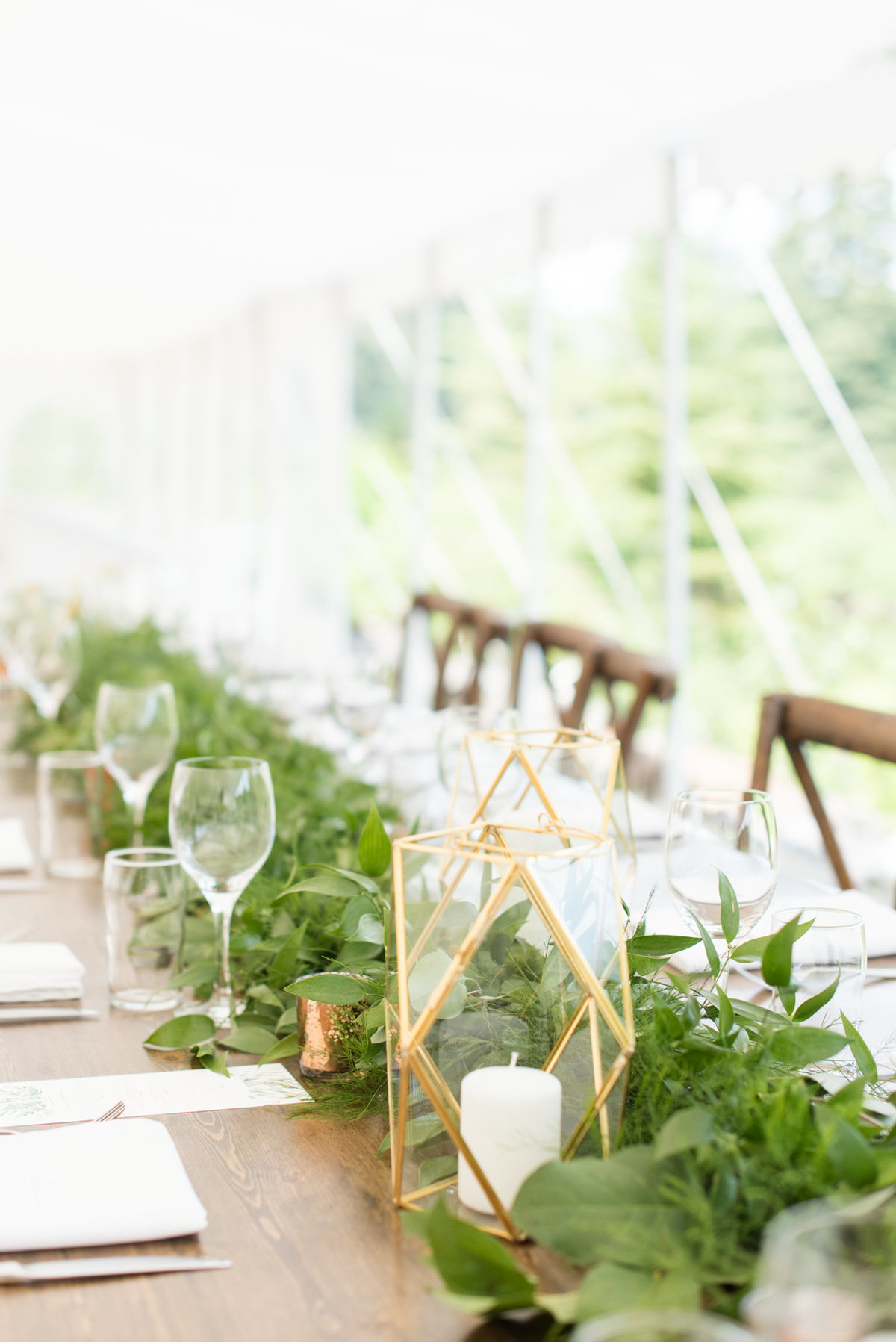 Geometric glass and gold candle holders and greenery table runner decorate Harvest Table from Tents & Events at Stepstone Centre wedding in Thunder Bay