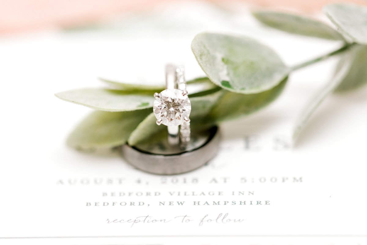 Light and Airy Wedding day detail photo taken by K. Lenox Photography.   Diamond solitaire ring and wedding bands.