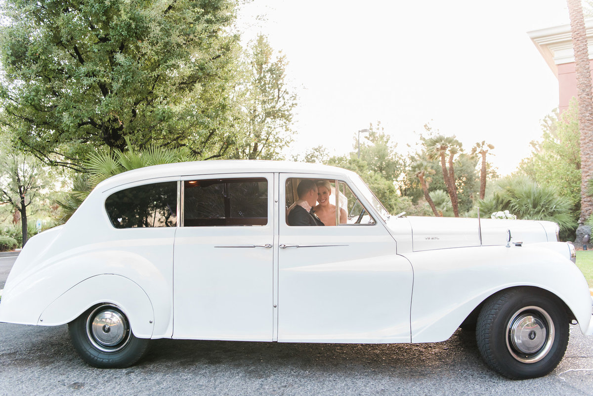 bride and groom in a vintage white car at the JW Marriott Resort Las Vegas