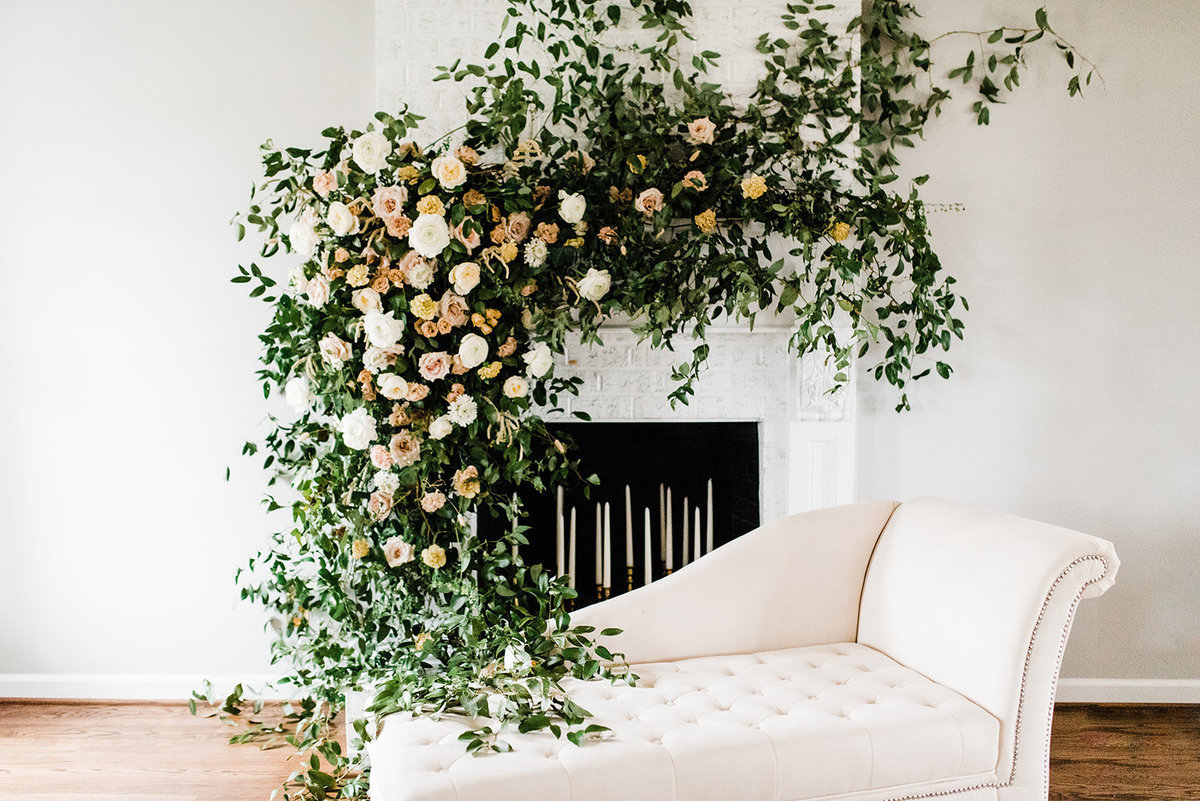 floral installation on fireplace