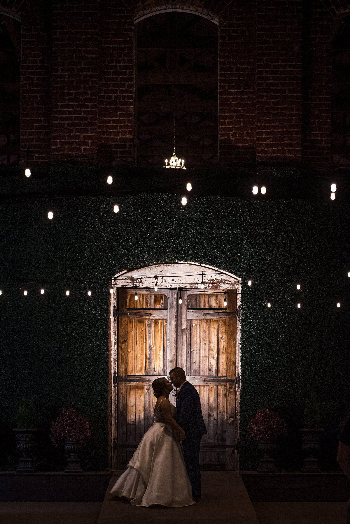 Silhouette of bride and groom at night