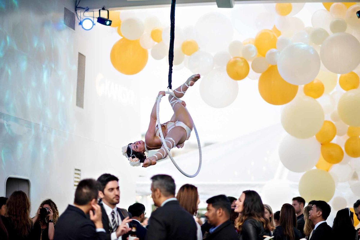 aerial artist at company party with balloon installation