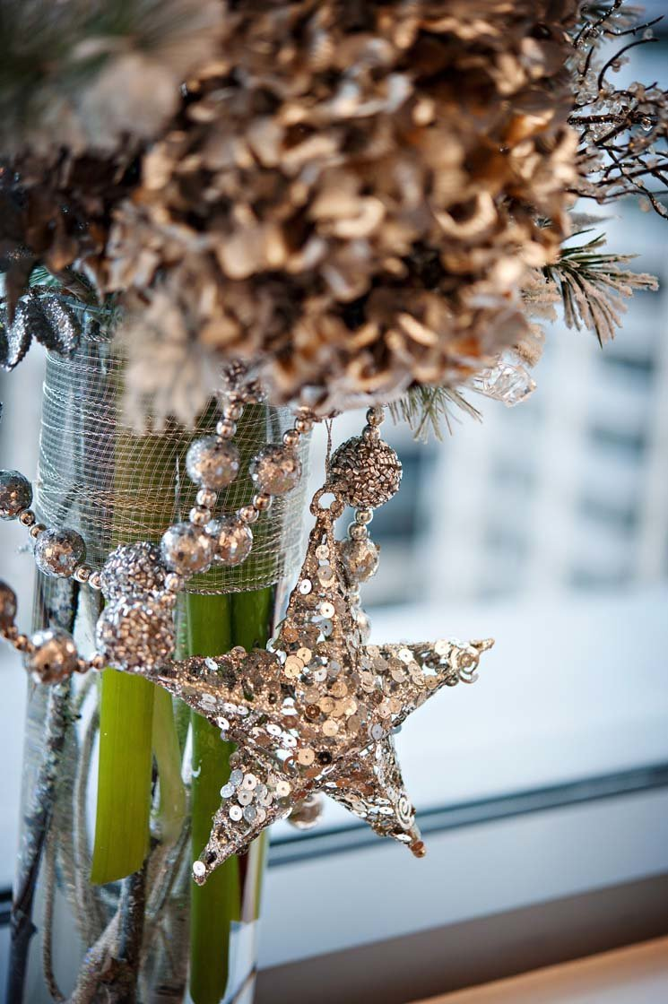 silver sparkle star hanging off a tall centerpiece for holiday party