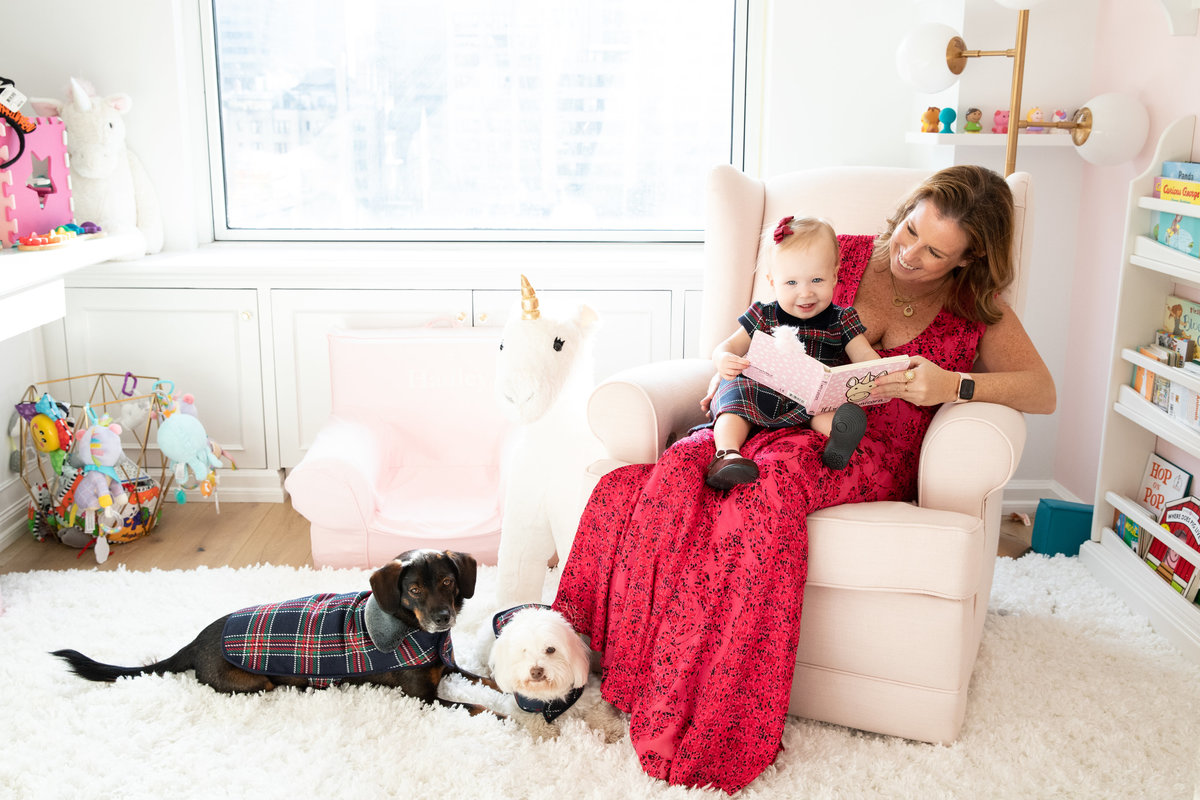 Single mom poses with her baby daughter and two dogs in her Manhattan apartment.