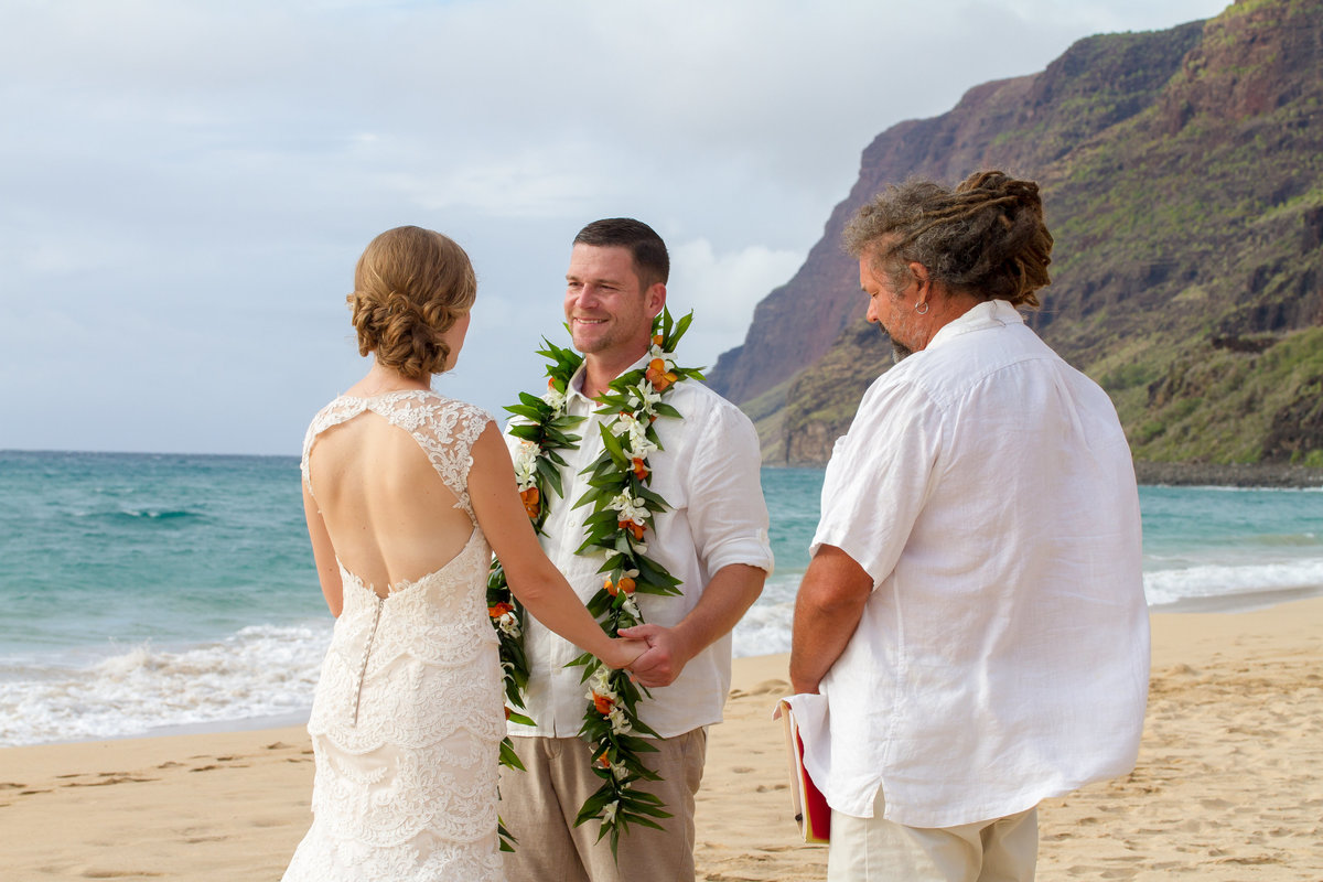 Couple getting married at Polihale beach, Kauai, Hawaii.