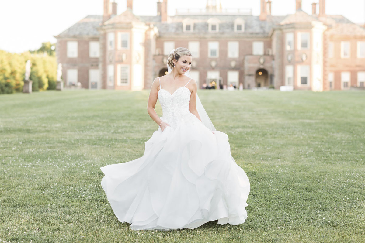 Bride twirling in dress