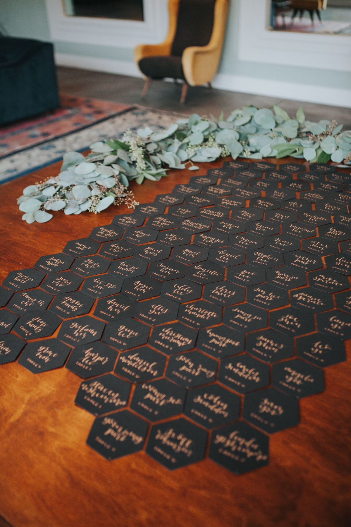 Minimalist and modern wedding with geometric seating chart display at The Fig House