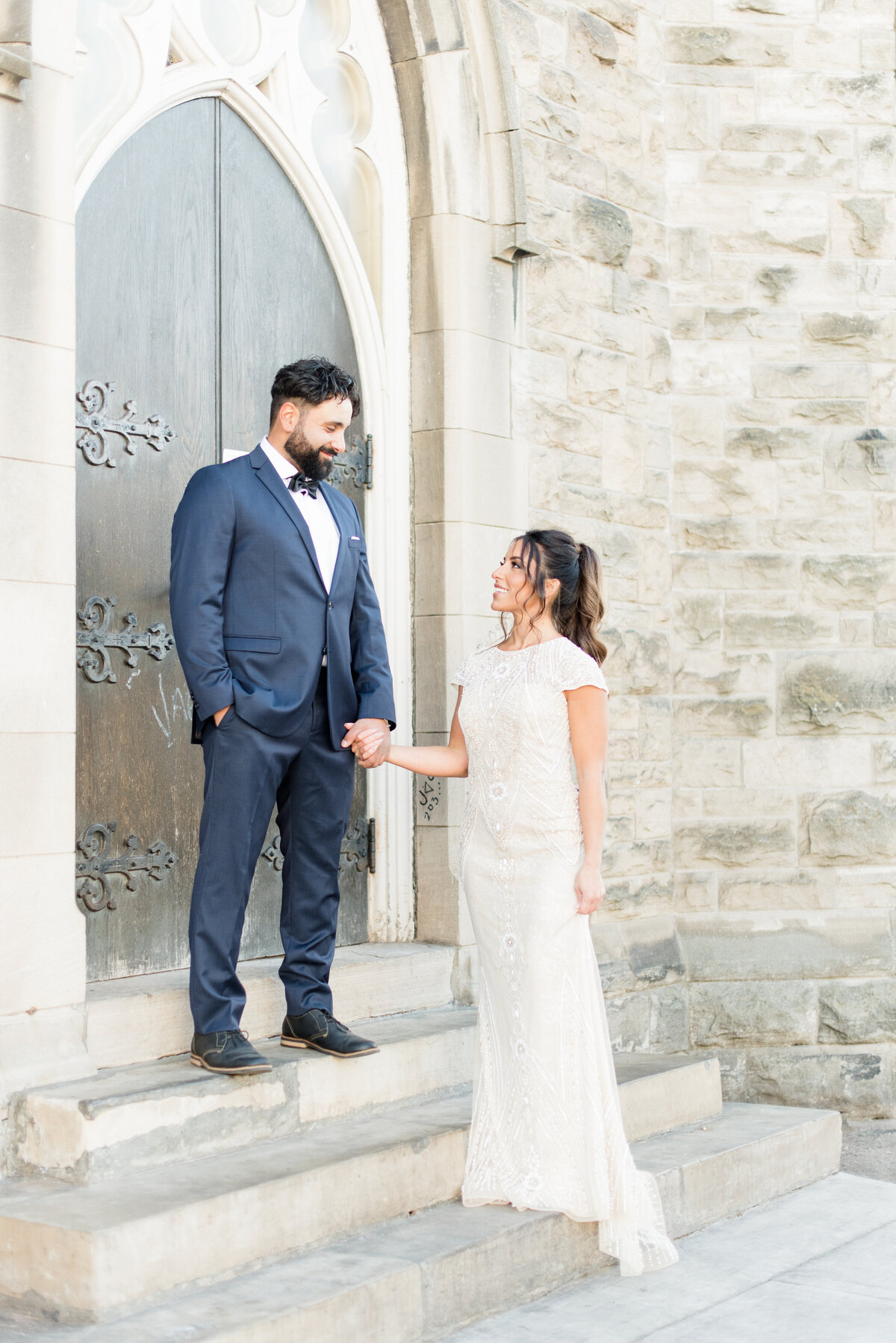 A model couple pose outside St. Andrew's Church in Thunder Bay during an editorial shoot