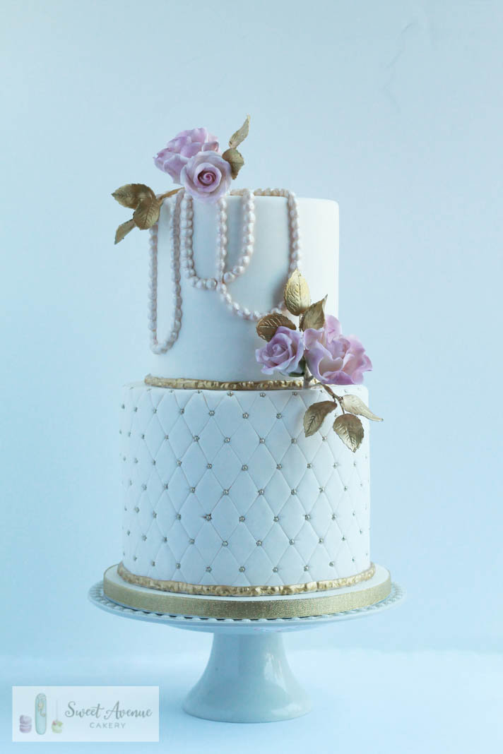 white and gold vintage wedding cake with pearls and blush roses