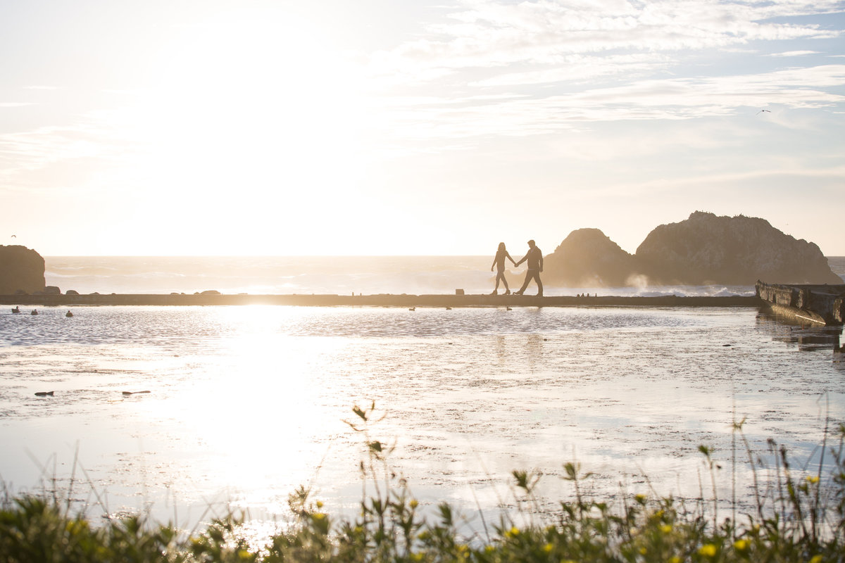 engaged couple poses at sutro baths in san francisco for engagement photos