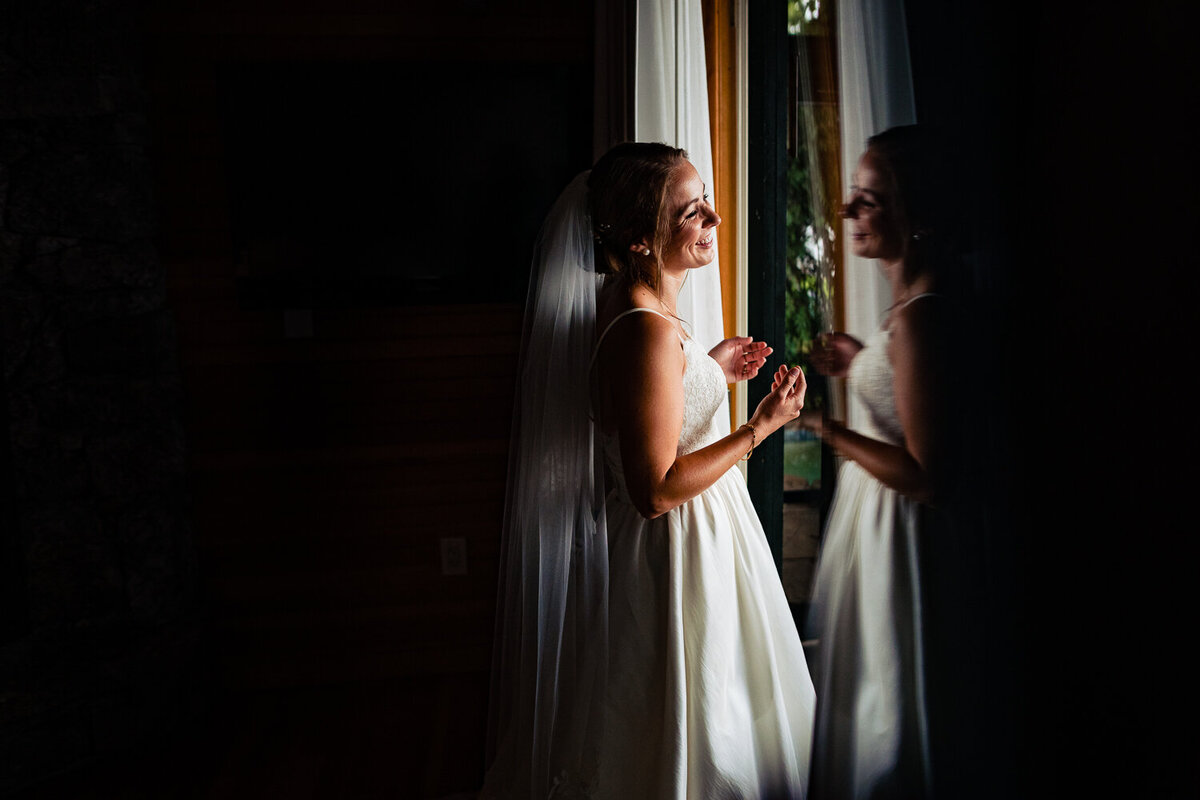 Bride-in-sheer-wedding-dress-with-vail-by-andy-madea-photography